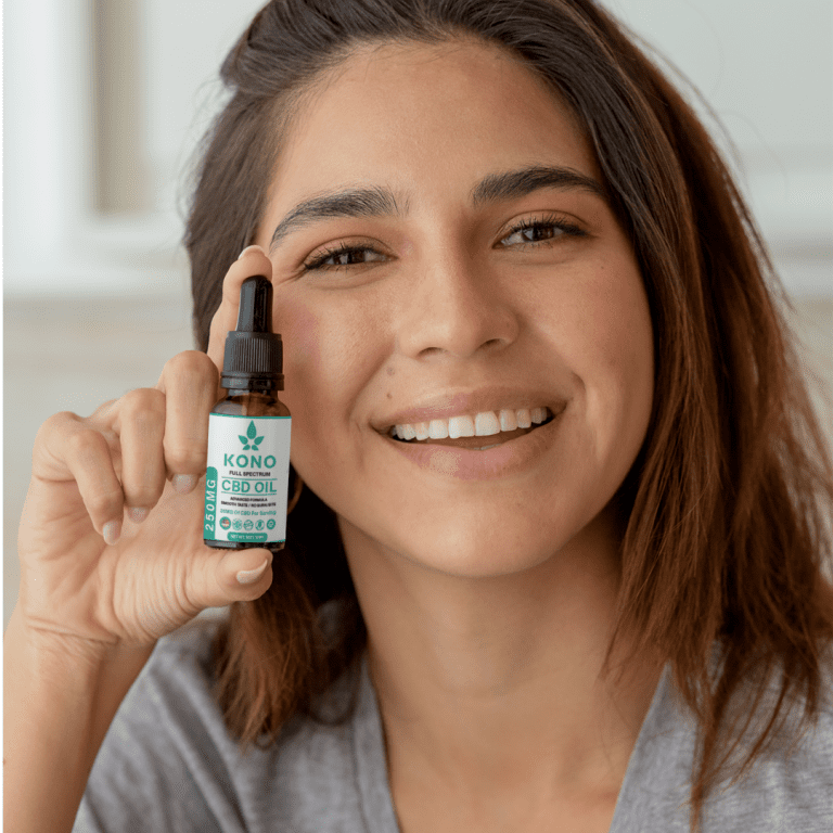 customer posing with a bottle of full spectrum cbd oil
